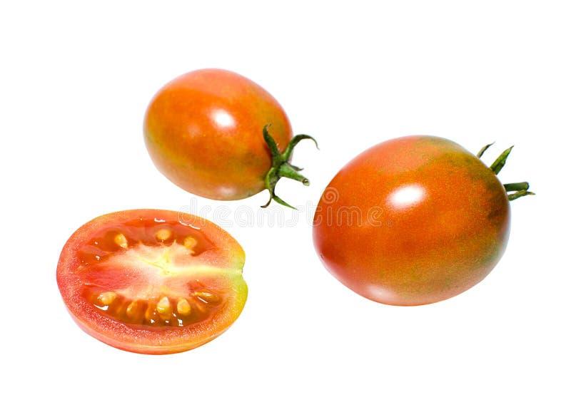 Saftiga tomater som isoleras på vit bakgrund royaltyfri bild