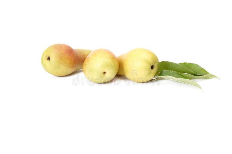 Saftige, geschmackvolle Birnen auf einem Weiß. lizenzfreie stockbilder