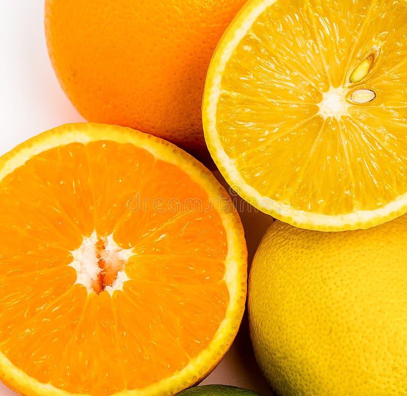 Saftige tropische orange Orange und gelbe Zitrone stockbild