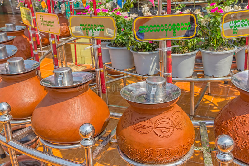 Sagaing hill clay pots. With water for drinking. Above each pot is written to whom is dedicated. Great tourist attraction, Myanmar stock image