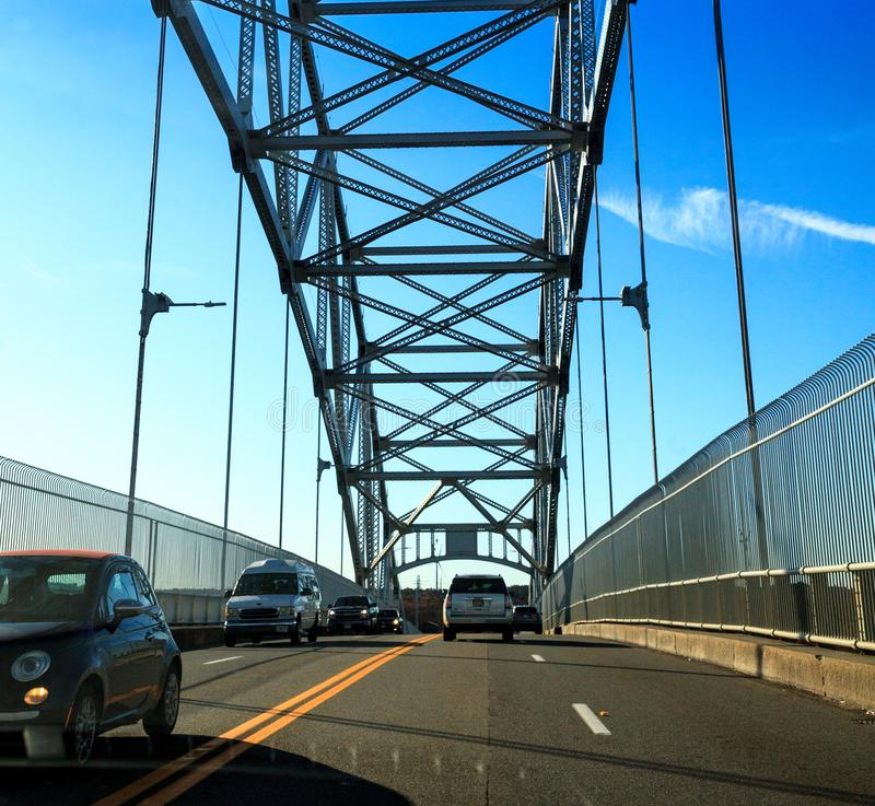 Sagamore Bridge in Bourne, Massachusetts on the highway headed toward the City of Boston. Bourne, Massachusetts, USA – November 10, 2019: Sagamore Bridge royalty free stock photos