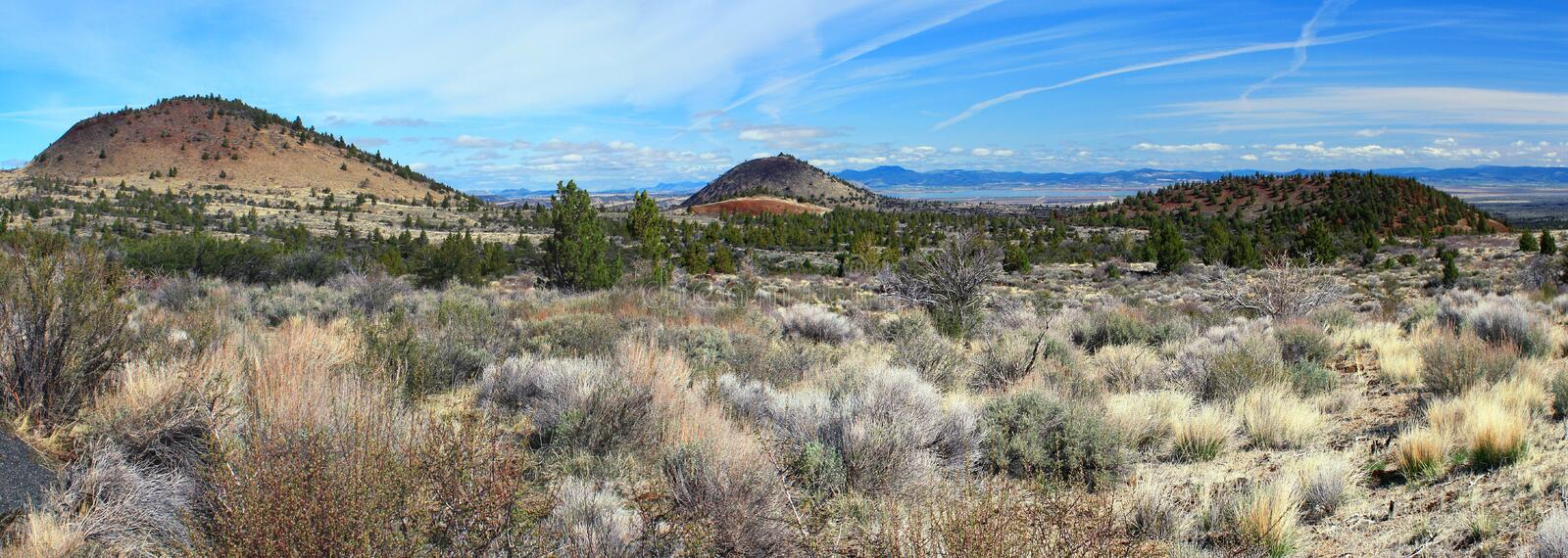 Landscape Panorama of Cinder Cones from Sunshine Cave Entrance, Lava Beds National Monument, California, USA. Panorama of Sagebrush and Juniper trees dominating stock photography