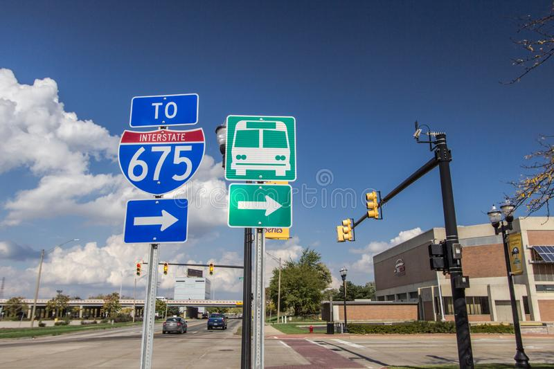 City Streets Of Downtown Saginaw Michigan. Saginaw, Michigan, USA - October 9, 2018: Streets of downtown Saginaw with signs for bus station and Interstate 75 royalty free stock images