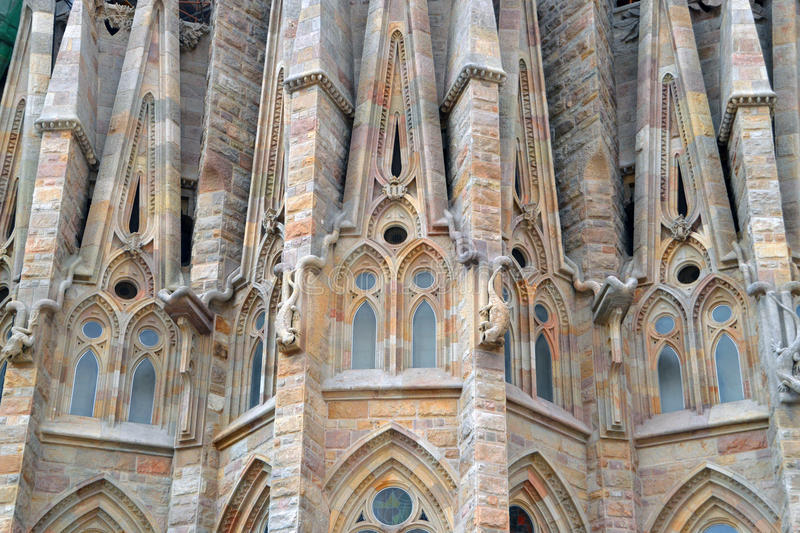 Sagrada Familia. In Barcelona center captivates with its extremely high towers and adorned with bows. Cathedral commissioned by the project by famous Spanish stock photo