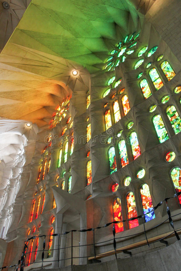 Sagrada Familia strained glass windows, by Antoni Gaudi, Barcelona. Ceiling was covered in colorful light from strained glass stock photos