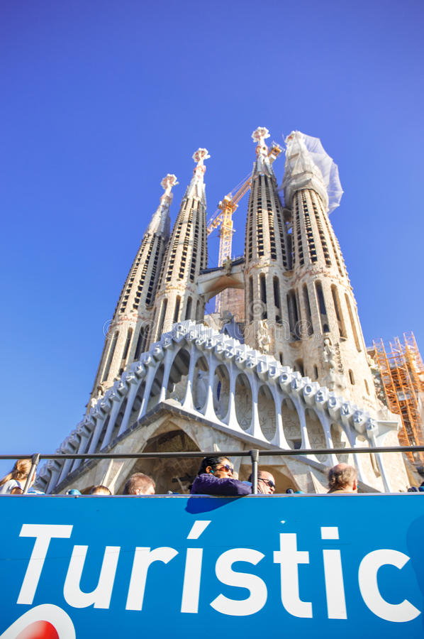 Sagrada famlia. Sagrada family in the tourist area of great interest.nIn the foreground is filled with tourists and tourist bus in the middle ground was made stock photography