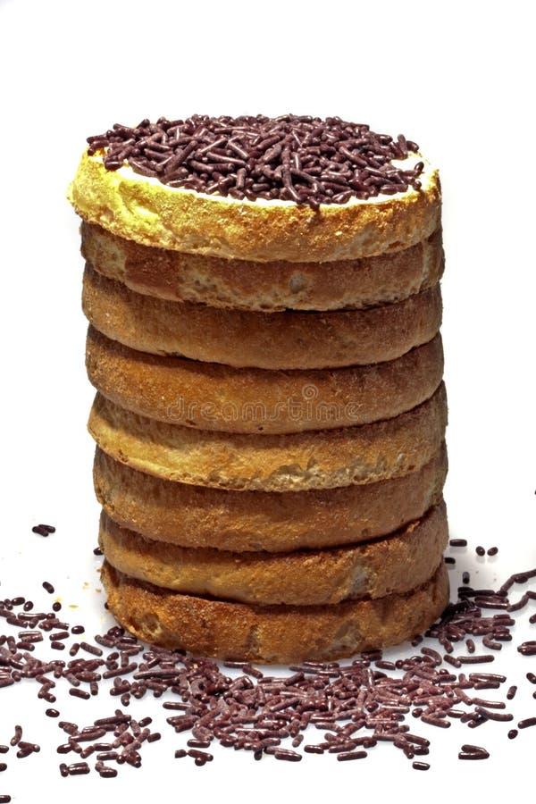 Sahnecracker mit Butter und Schokolade spritzt stockbilder