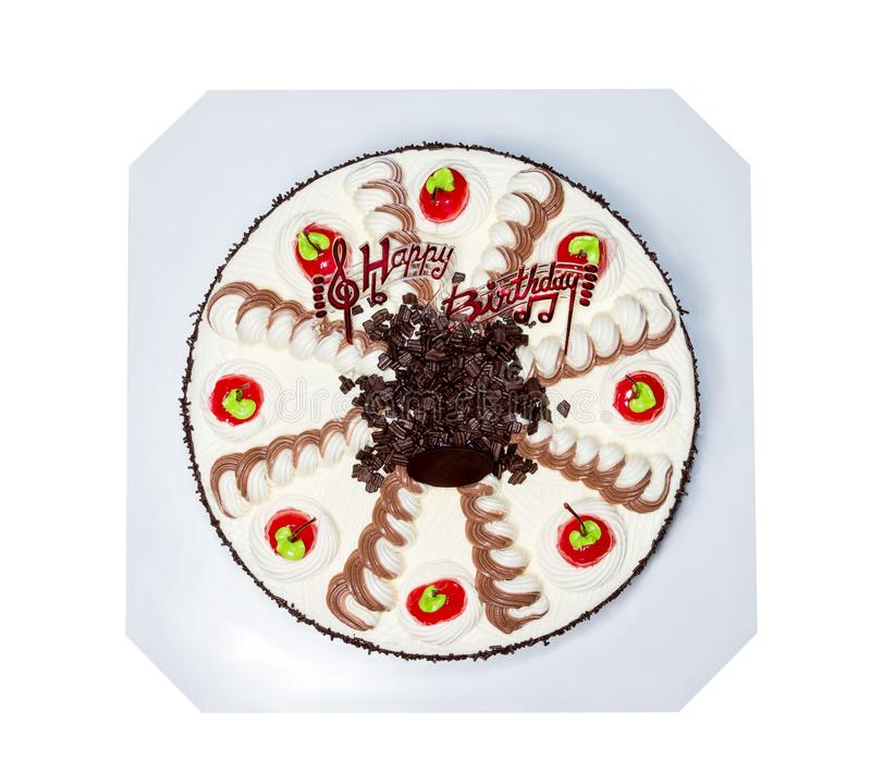 Sahnekuchen mit der roten Kirsche lokalisiert auf dem weißen Hintergrund, befestigend stockfotografie