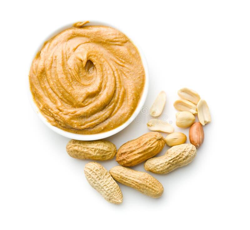 Sahnige Erdnussbutter und Erdnüsse stockbild