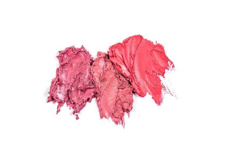 Sahniger Lippenstift für Make-up Abstriche auf weißem Hintergrund Rote und braune Beschaffenheiten lokalisiert auf weißem Hinterg lizenzfreie stockfotos