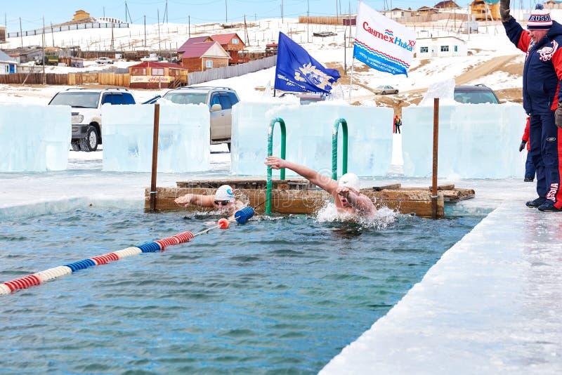 SAHYURTA ,IRKUTSK REGION, RUSSIA - March 11.2017: Cup of Baikal. Winter Swimming. Butterfly royalty free stock photos
