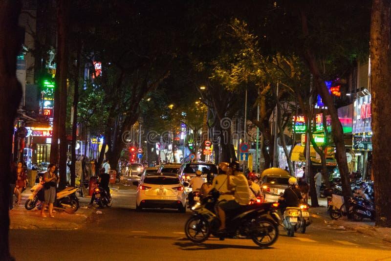 Saigon night traffic Vietnam. Ho Chi Minh City, Vietnam - May 13, 2018: Motorbikes traffic in a small street in central Saigon by night royalty free stock photo