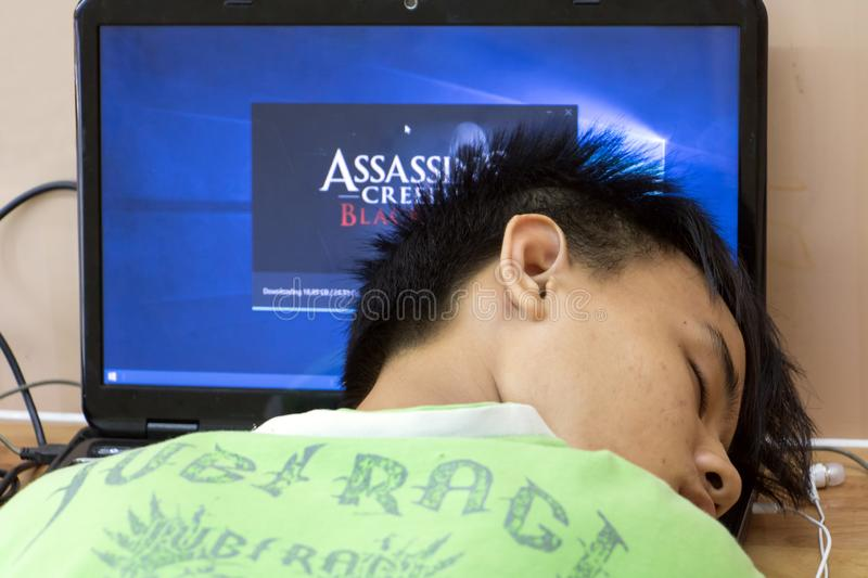 A tired game player sleep on a computer keyboard. royalty free stock photography