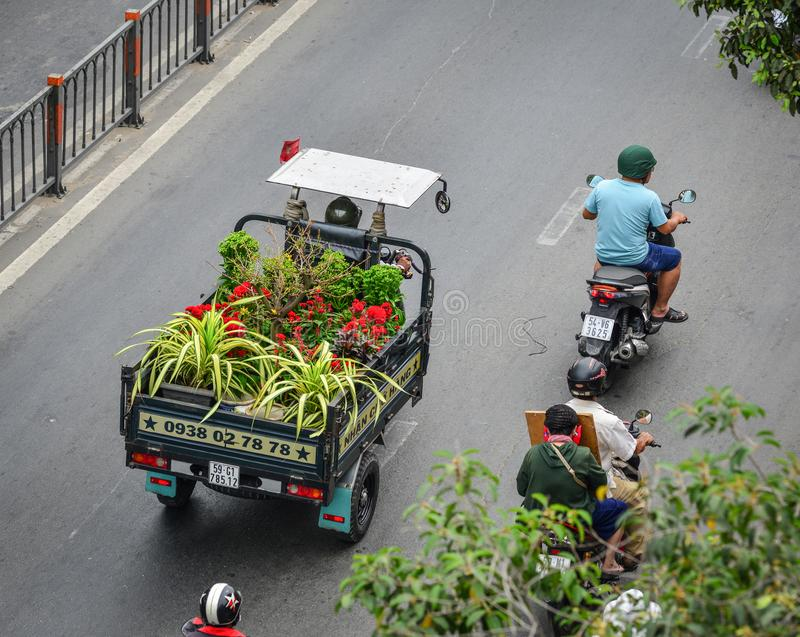 Vietnamese delivery tricycle on street stock photos