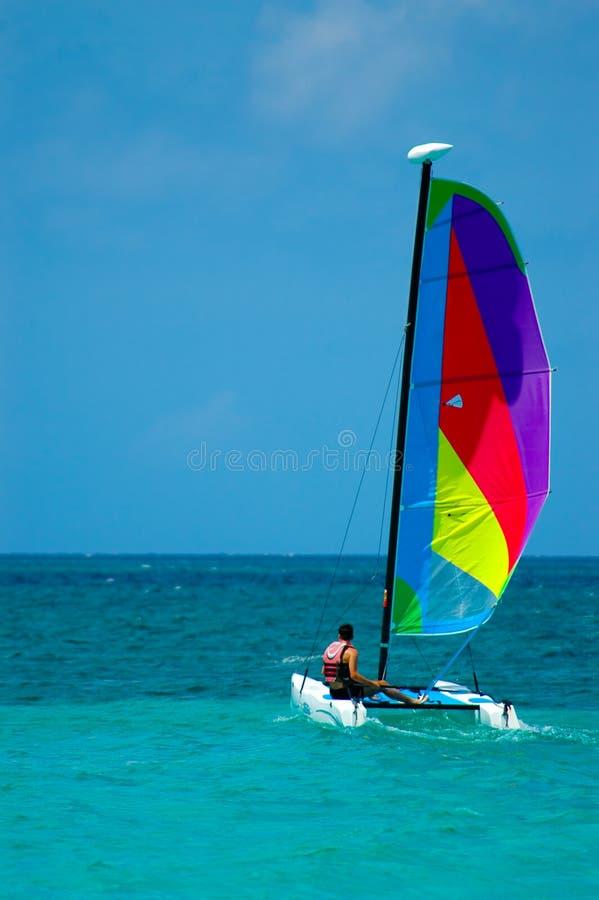 Sail. Colourfull sail, Negrils Beach Jamaica royalty free stock image