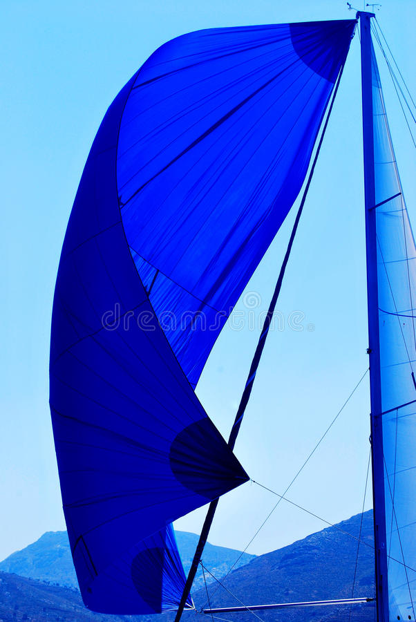 Sail. Blue sail on mast against the sky royalty free stock photo