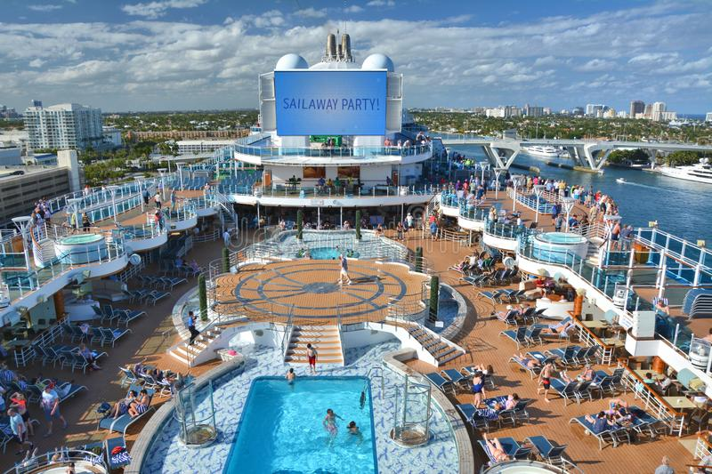Sail away party on open deck in pool area on the cruise ship. FORT LAUDERDALE, USA - MARCH 20, 2017 : Royal Princess ship sails away from Port Everglades in Fort royalty free stock images