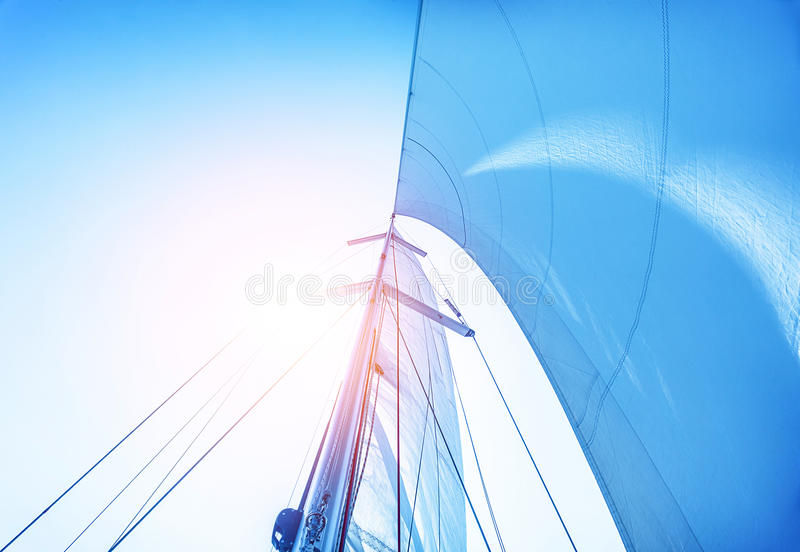 Sail on blue sky background royalty free stock photos