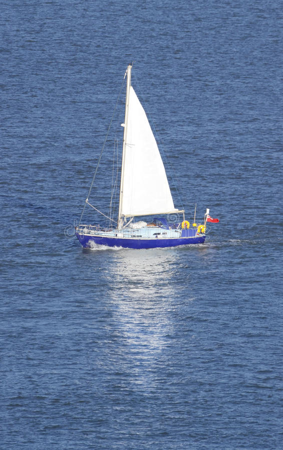 Sail Boat. Beautiful blue sail boat with deep blue background. I use an ultra high quality CANON L SERIES lens to provide you the buyer with the highest quality royalty free stock photos