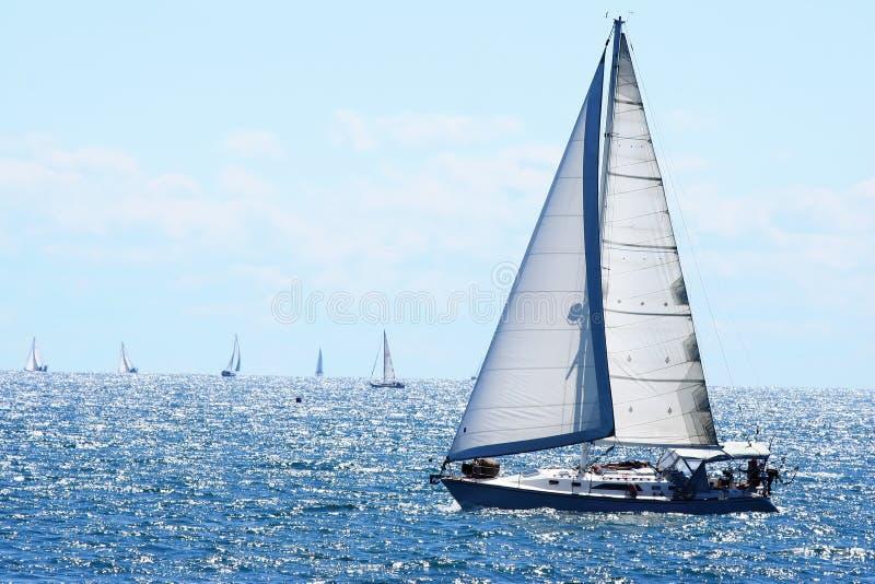 Sail boat. Sailboat with sails up on lake stock photos