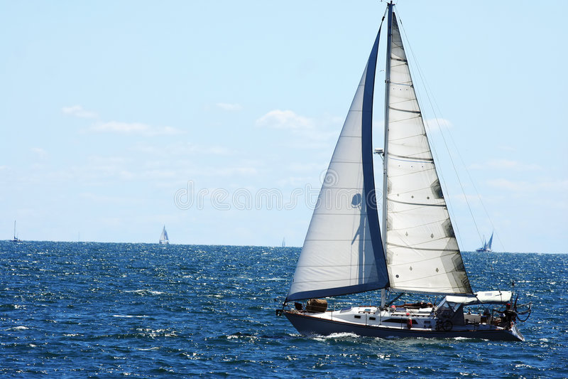 Sail boat. Sailboat with sails up on lake stock images