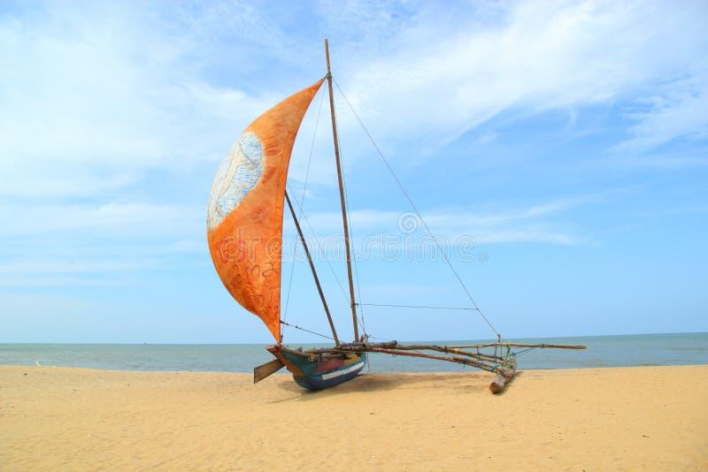 Sail boat on the beach. Oruwa - traditional Sri Lankan sail boat in Negombo stock photo