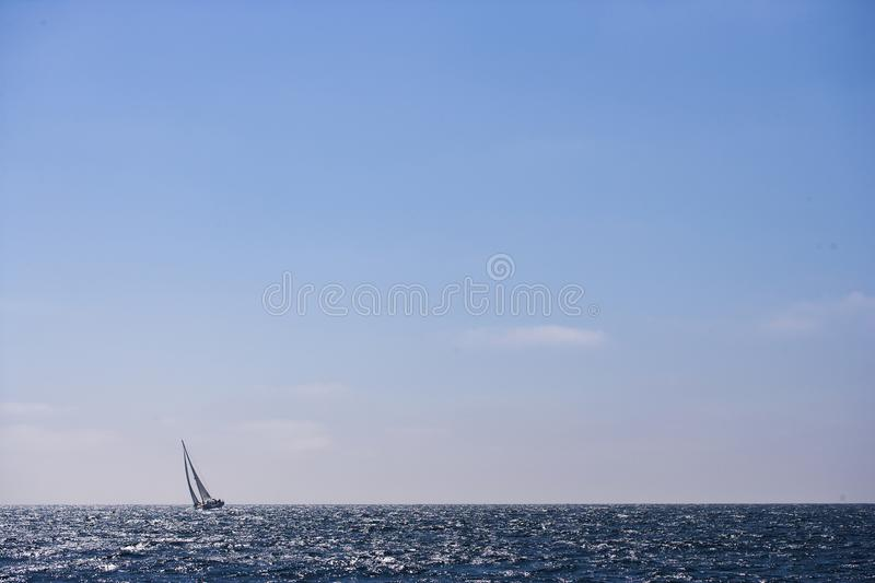 Sail Boat on Blue Sea royalty free stock photography