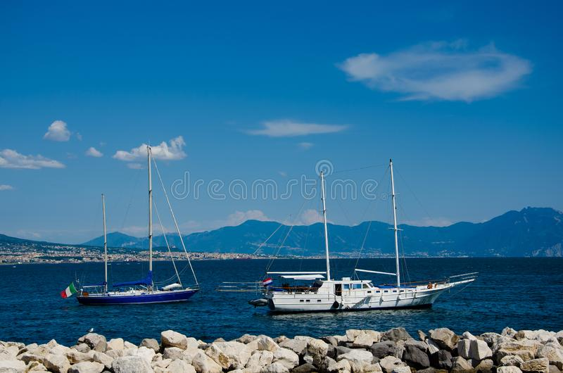 Sail boat on mountains background on the gulf of Naples in Italy. Tourism and recreation concept stock photo