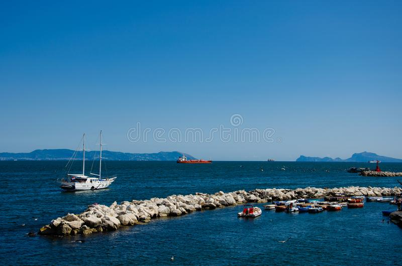 Sail boat on mountains background on the gulf of Naples in Italy. Tourism and recreation concept stock image