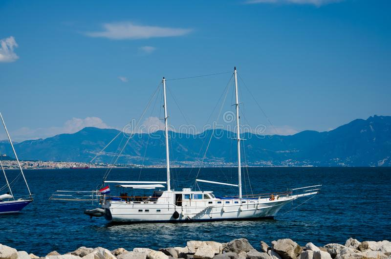 Sail boat on mountains background on the gulf of Naples in Italy. Tourism and recreation concept royalty free stock photos