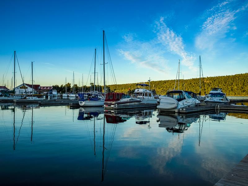 Sail boats docked int he Marina, Gore Bay, ON, Canada. Gore Bay Marina with recreational boats , Manitoulin Island, ON, Canada royalty free stock photography