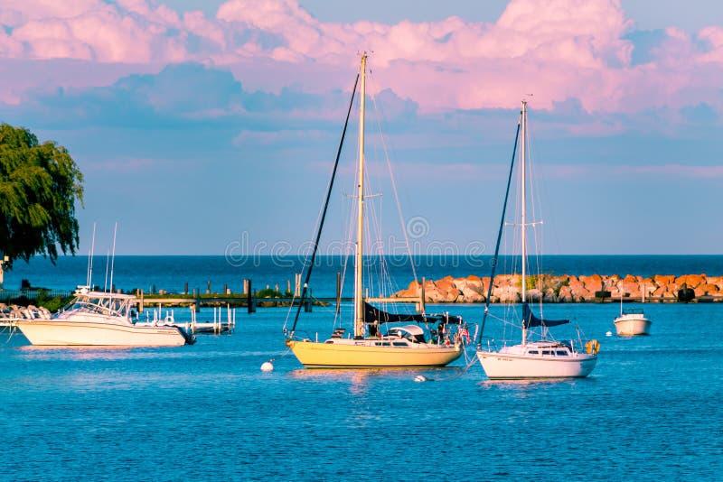 Sail boats docked at the marina at Mackinac Island during sunset royalty free stock photo