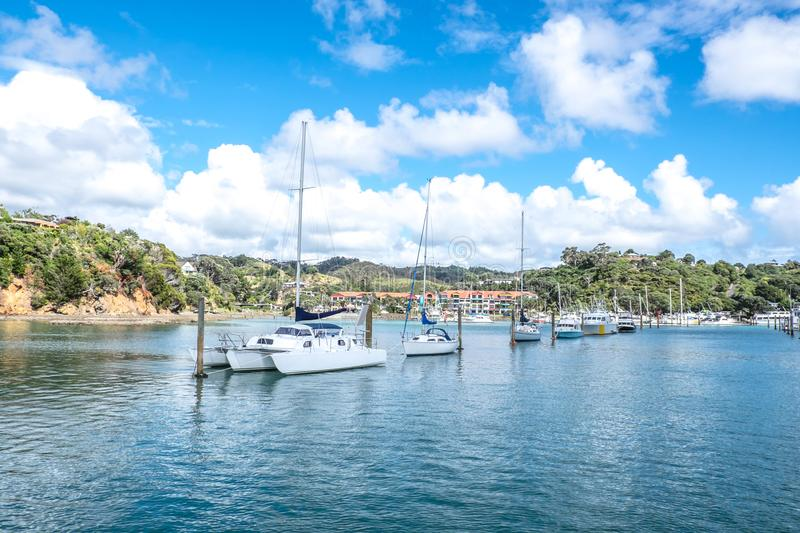 Sail boats and motor launches at pile moorings in entrance to Tu royalty free stock image