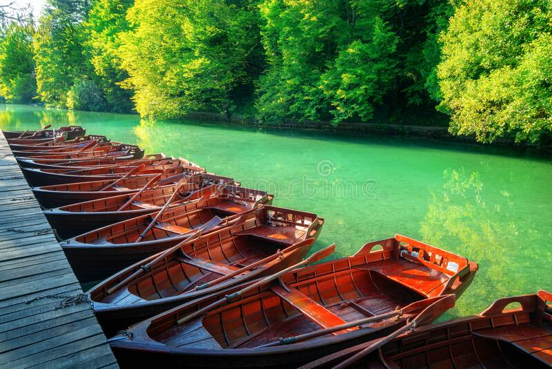 Sail boats parking in Plitvice Lakes Croatia. Boats parking at pier with turquoise lake landscape of Plitvice Lakes National Park, UNESCO heritage, famous travel stock images