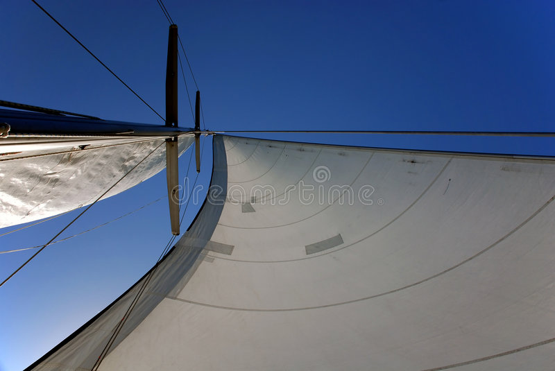 Sail & mast. With clear blue sky in the background stock photos