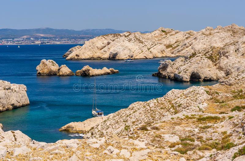 Sail sheltered in Frioul Island creek. In front of Marseille, by boat, you can visit Frioul Island. Quiet place to refresh, swim, walk or go on sail boat royalty free stock photography