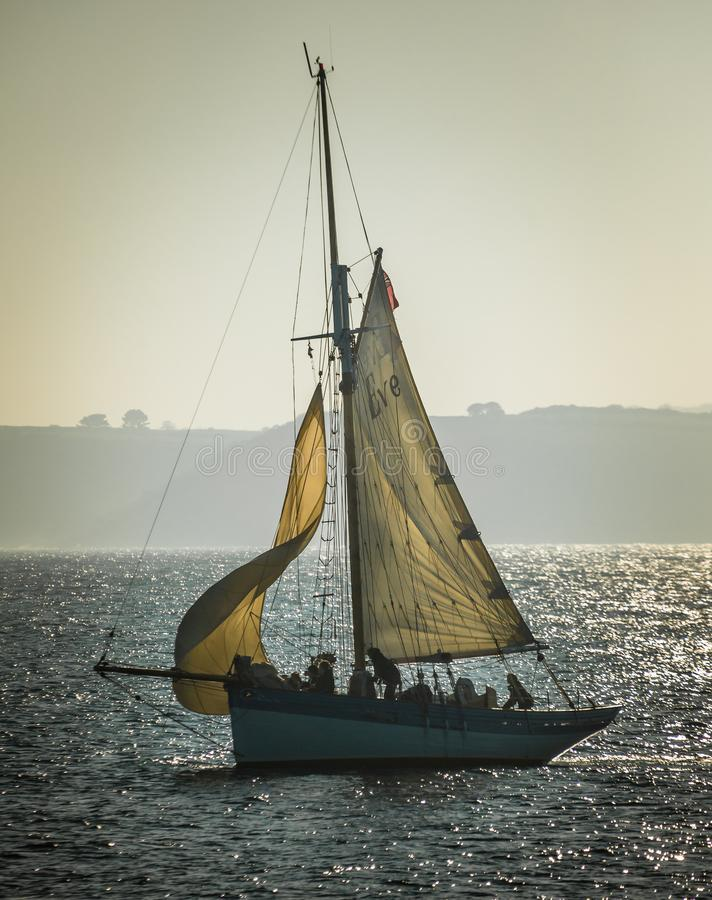 Sail Training on traditional wooden heritage yacht in the Fal Es. Sail Training on traditional wooden heritage yacht in the beautiful Fal Estuary, Cornwall royalty free stock photo
