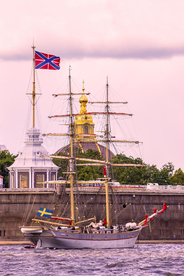 Sailboat against a background of Peter and Paul Fortress, St. Pe royalty free stock images