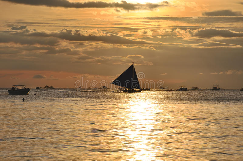 Sailboat against beautiful sunset in Boracay
