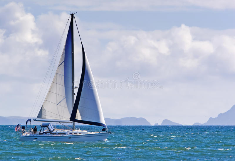 Sailboat and Anacapa Island royalty free stock images