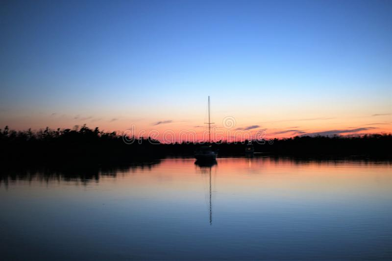 Sailboat anchored in Blue Hill Creek Goodland Florida at sunset stock image