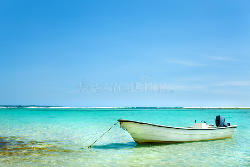 Sailboat anchored in Caribbean sea royalty free stock photography