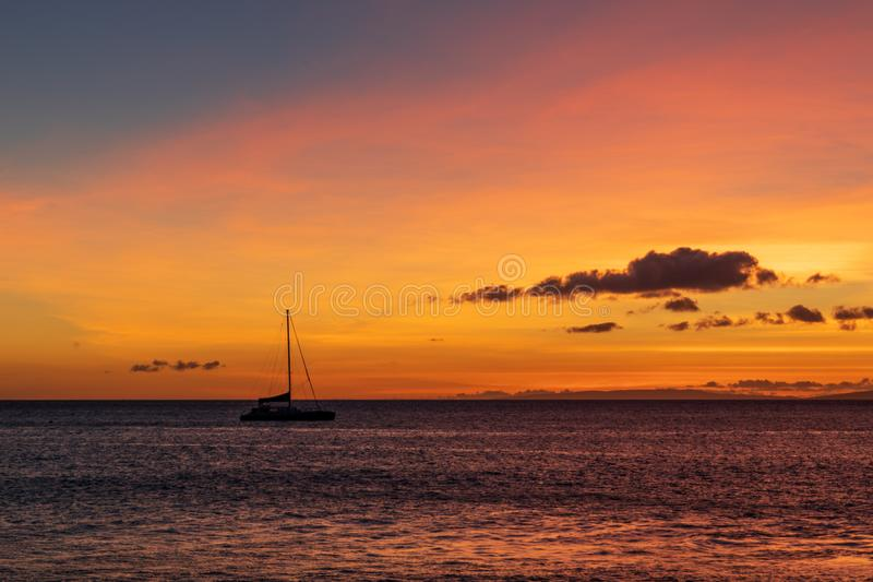 Sailboat anchored in a Maui channel during a beautiful Hawaiian sunset stock image