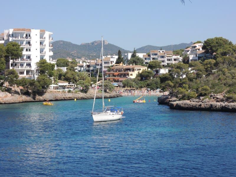 Sailboat anchored in natural harbor. Sailboat anchored in the natural harbor near Cala d'Or, Mallorca, Spain royalty free stock image