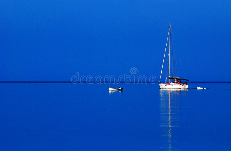 Download Sailboat on blue water stock image. Image of calm, stillness - 3075373