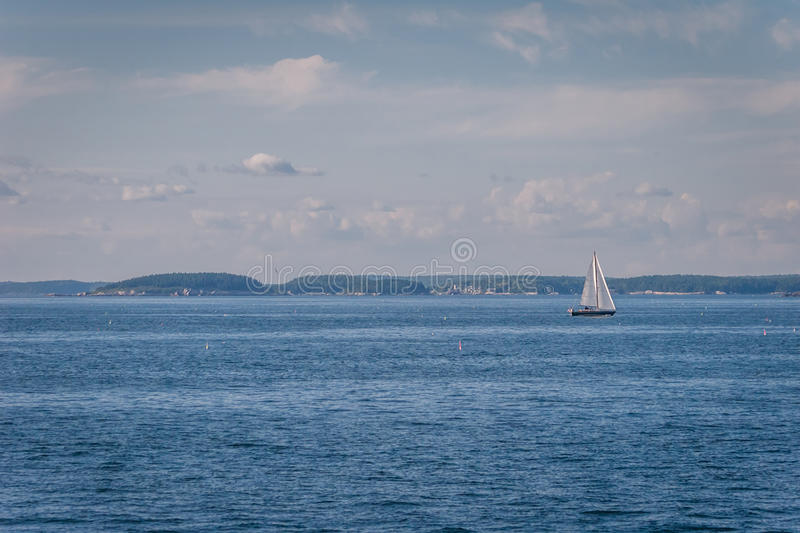 Sailboat. In blue waters near the coast of Maine royalty free stock image