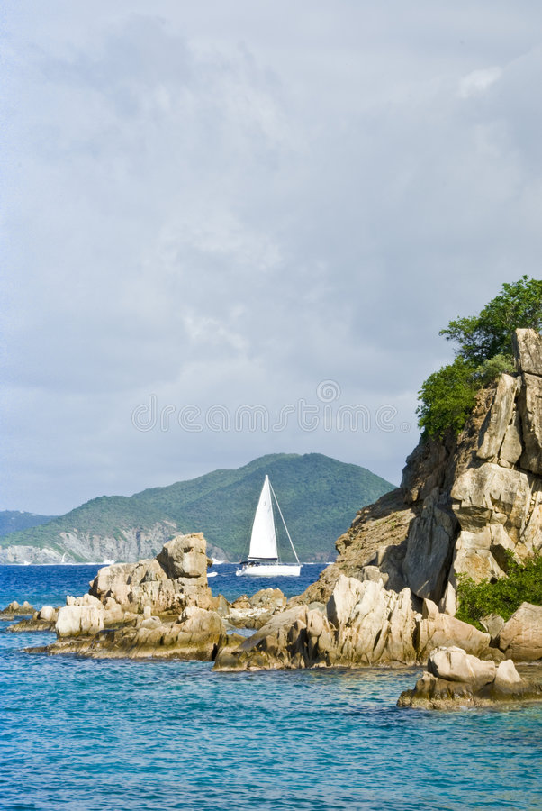 Sailboat in coastal scenery. Location is Norman Island in the British Virgin Islands stock photography