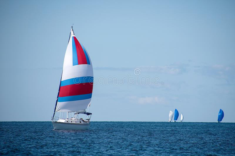 Sailboat with colorful spinnaker. Sail boats in race with colorful spinnakers on Lake Michigan royalty free stock photography