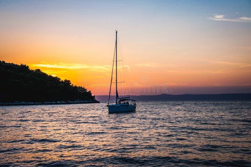 Sailboat at Vela Luka, Korčula during sunset. royalty free stock image