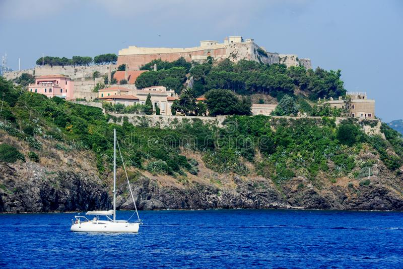 Sailboat cruising in front of Portoferraio on Elba island royalty free stock image